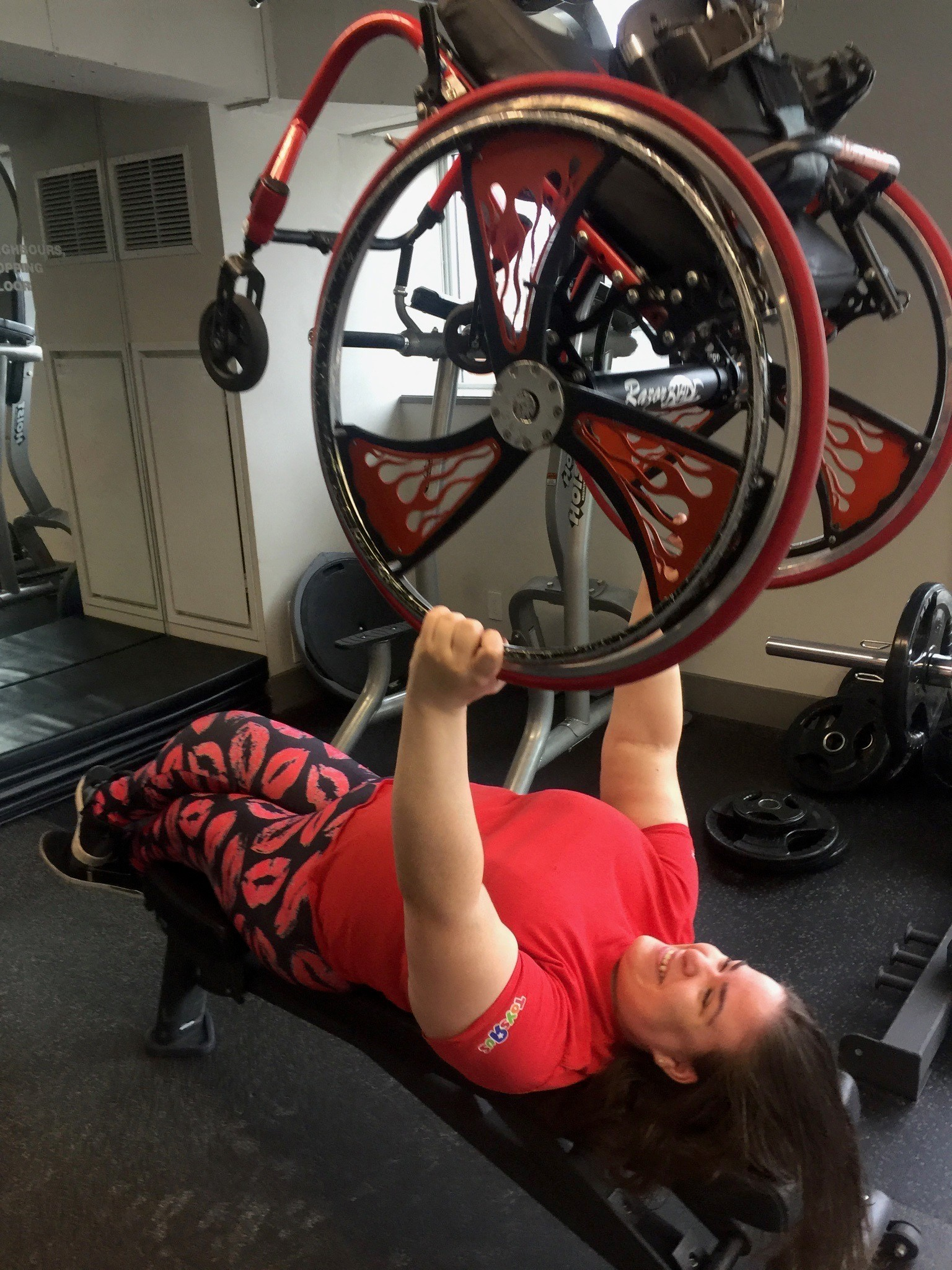 Jenna uses her wheelchair as a weight during a workout