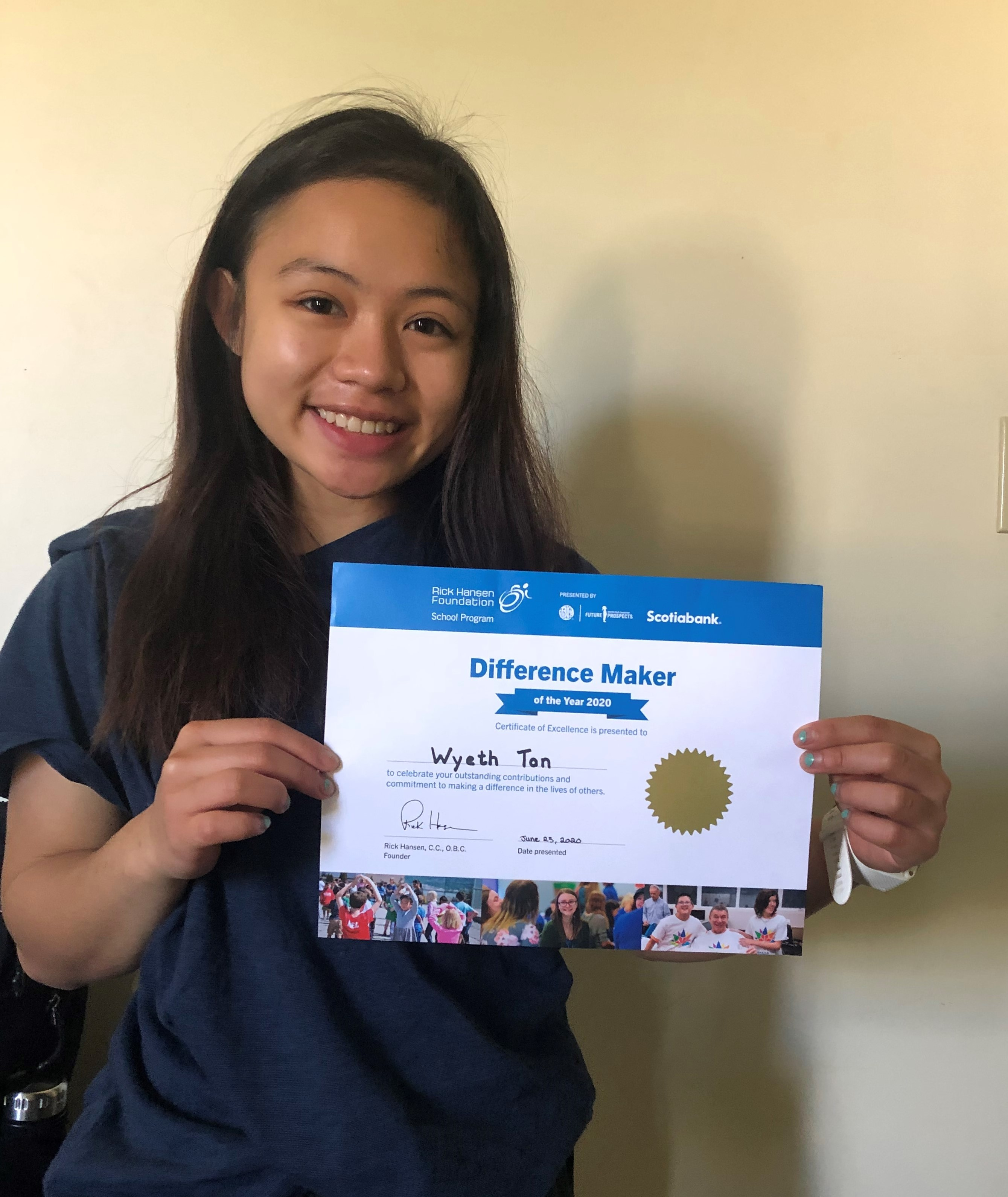 Wyeth holding her certificate, smiling