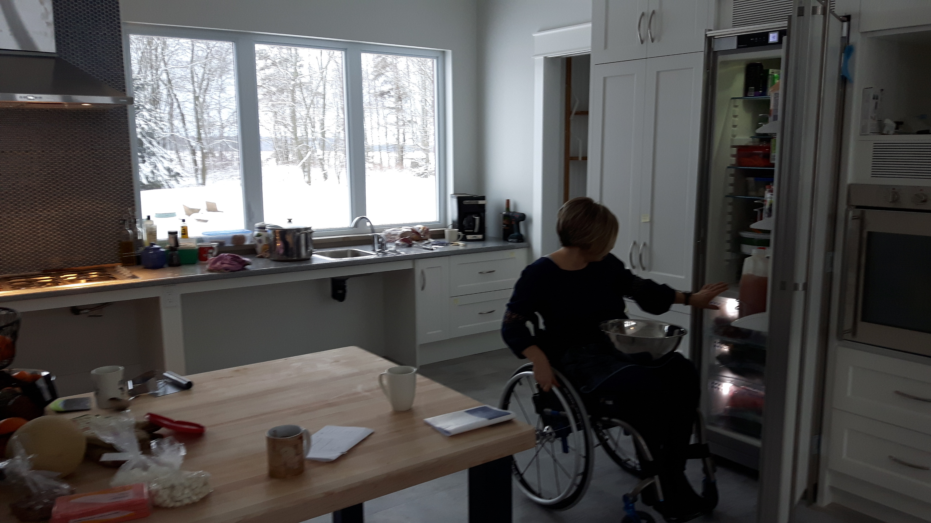 Julie uses her recently completed fully accessible kitchen in her wheelchair