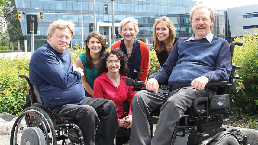 Group photo, with two people using wheelchairs.