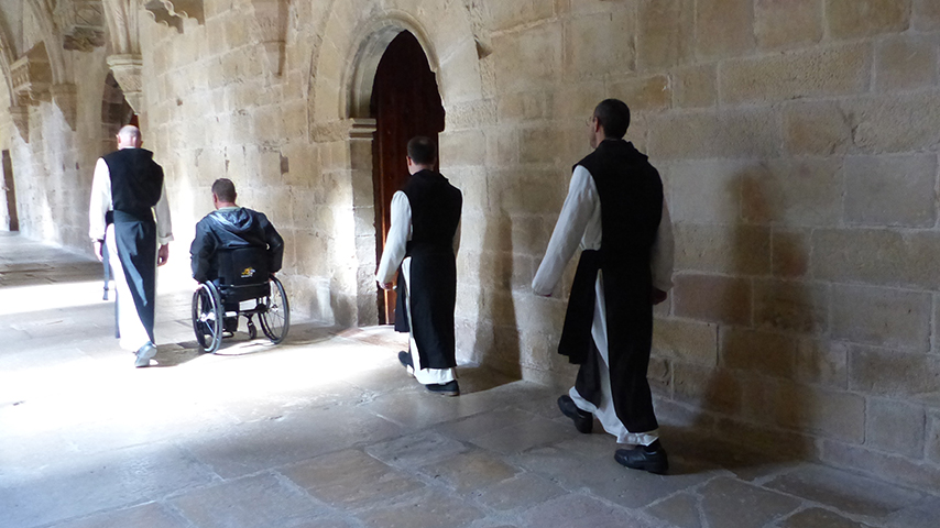 Rick and monks in Poblet Monastery.