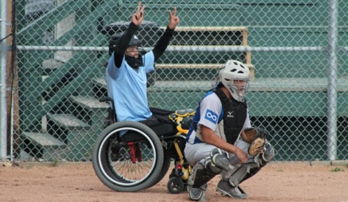 Trent Seymour playing fastball in his wheelchair