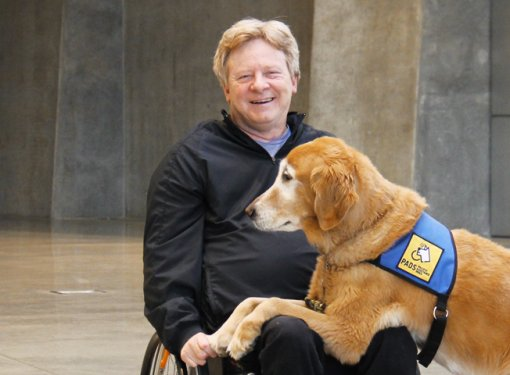Brad McCannell and his service dog Chipper