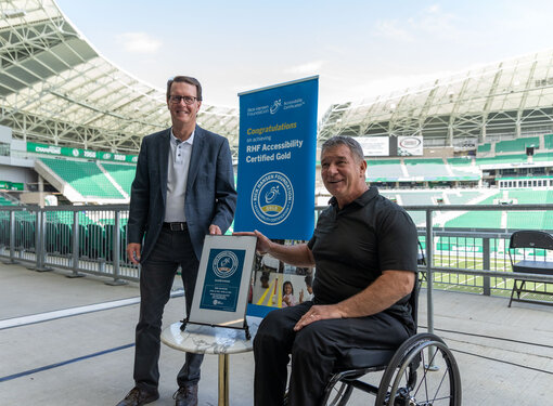 Rick Hansen at Mosaic Stadium with plaque