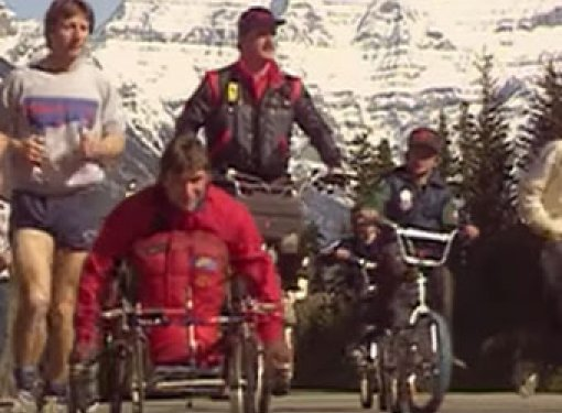 Rick Hansen wheels along the highway during the Man in Motion World Tour