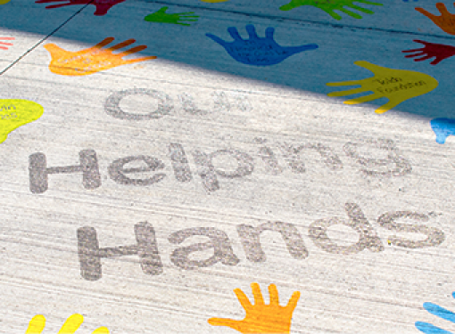 Our helping hands pavement art at accessible playground