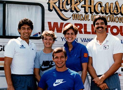 Rick Hansen and his team standing in front of their motor home during the Man in Motion World Toura