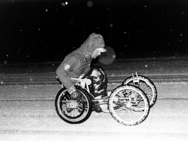 Rick Hansen wheeling in his winter 4x4 chair near Parry Sound, Ontario on December 6, 1986.