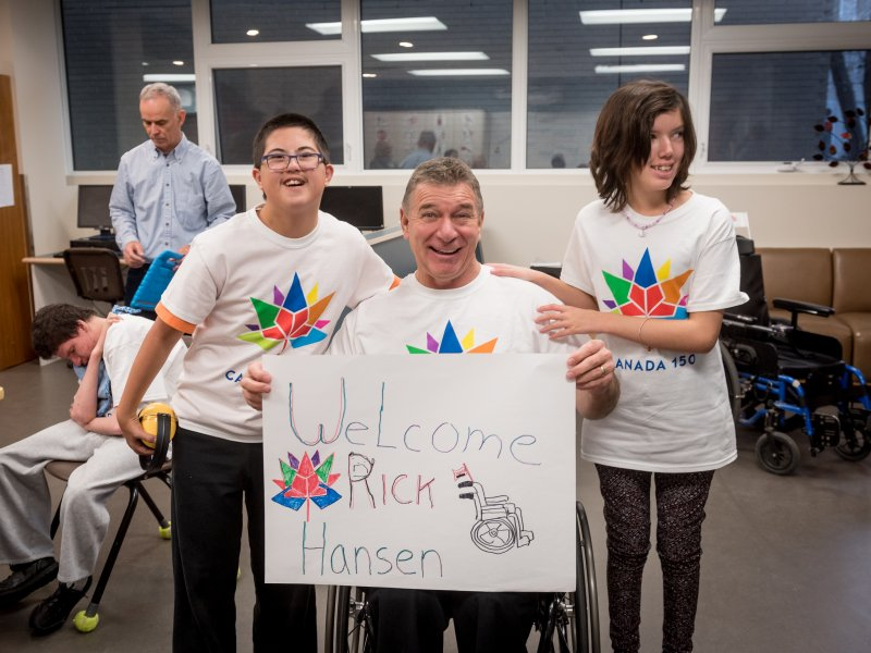 Rick Hansen and students at a school which received a Canada 150 Signature initiative Barrier buster grant