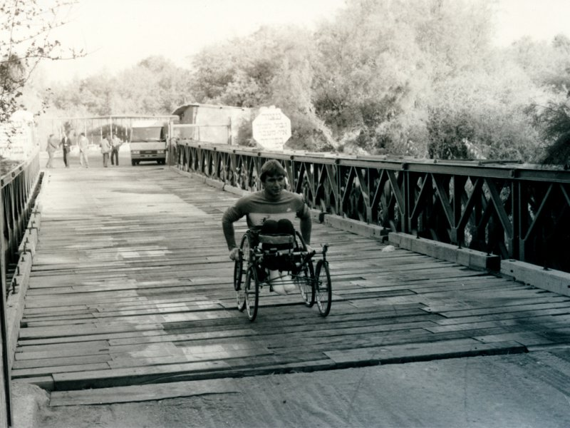 Rick Hansen wheeling across Allenby Bridge in Jordan.