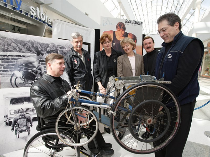 Rick Hansen and team at the Rick Hansen display