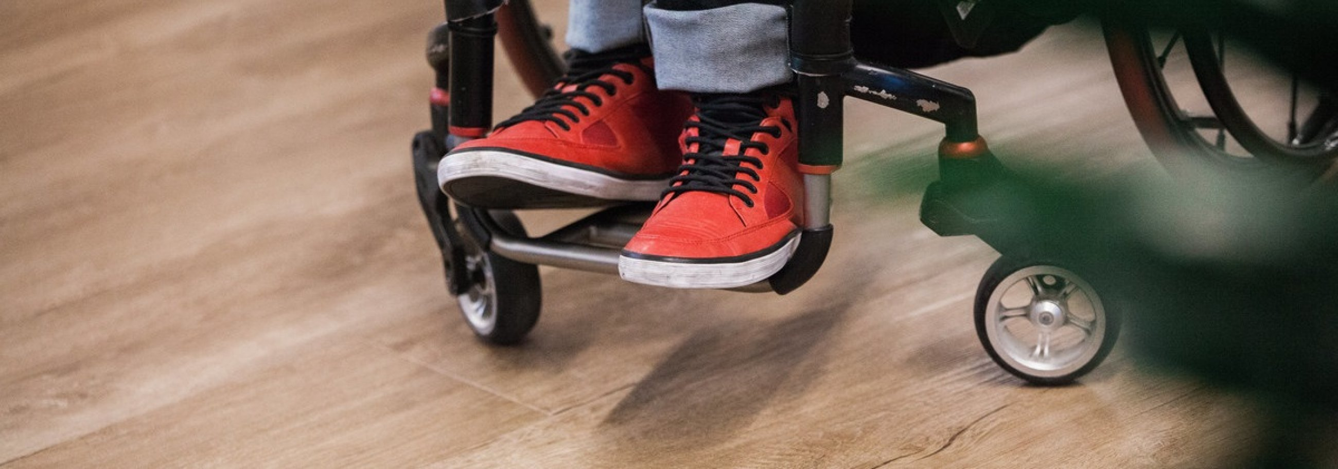 wheelchair wheels and red sneakers