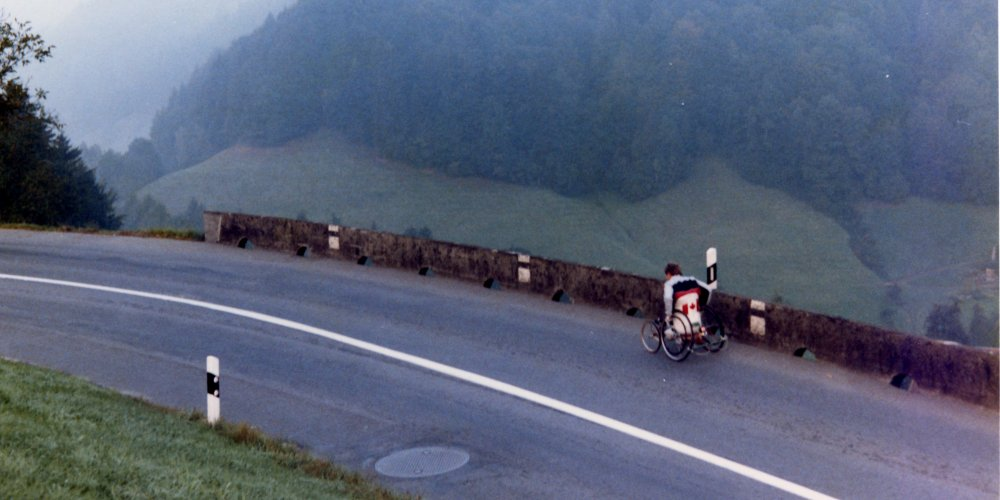 Rick Hansen wheeling up a steep grade in the Swiss Alps during early October of 1985.