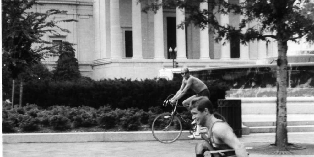 Rick wheeling past the White House in Washington, D.C. in 1986