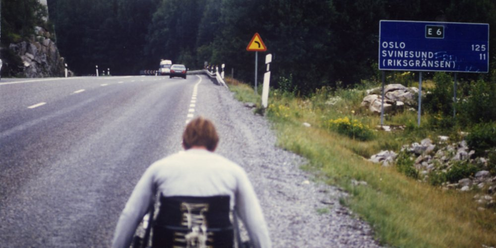 Rick Hansen wheeling in Norway eleven kilometers outside of Svinesund, Norway during August 1985.